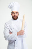 Male chef cook holding a rolling pin Royalty Free Stock Image