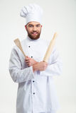 Male chef cook holding a rolling pin and spoon Royalty Free Stock Photos