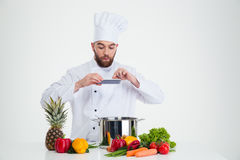Male chef cook making photo of food Stock Images