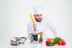 Male chef cook preparing pasta Stock Photos