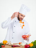 Male chef cook preparing salad Royalty Free Stock Images