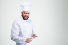 Male chef cook sharpening knife Stock Images