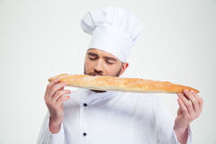 Male chef cook smelling fresh bread Stock Image