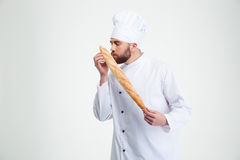 Male chef cook smelling fresh bread Royalty Free Stock Images