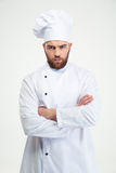 Male chef cook standing with arms folded Stock Images