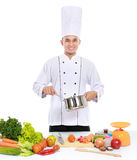 Male chef cooking Royalty Free Stock Images