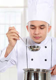 Male chef cooking Stock Images
