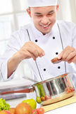 Male chef cooking Royalty Free Stock Photography