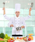 Male chef cooking in the kitchen Stock Photos