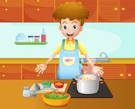 A male chef cooking in the kitchen Royalty Free Stock Photo