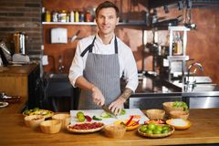 Male Chef Cooking Spicy Food royalty free stock photo