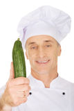 Male chef with a cucumber Stock Photo