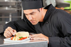 Male Chef Garnishing Dish Royalty Free Stock Photo