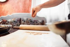 Male chef hand over dough, apple strudel cooking. Homemade sweet dessert, pastry preparation process Stock Image