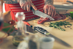 Male chef hands cutting meat on board Stock Photography