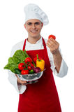 Male chef holding a fresh vegetables Stock Photo