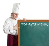 Male chef holding a notice board Royalty Free Stock Photography