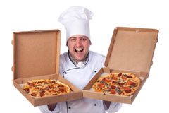 Male chef holding open two boxes of pizza. Male chef holding a pizza box worker, portrait Stock Photos