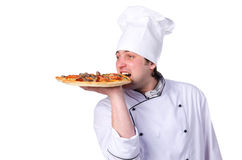 Male chef holding a pizza Stock Photos