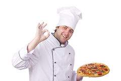 Male chef holding a pizza box open. Worker, portrait Royalty Free Stock Image