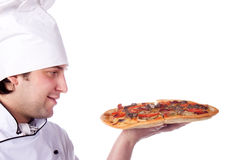 Male chef holding a pizza box open Royalty Free Stock Photo