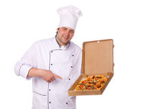 Male chef holding a pizza box open Royalty Free Stock Photography