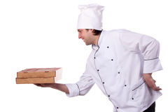Male chef holding a pizza box open Royalty Free Stock Photos