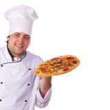 Male chef holding a pizza box open. Portrait male chef person cheerful, worker Royalty Free Stock Images