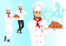 Male chef holding a tray with christmas roasted turkey Royalty Free Stock Image