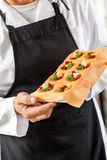 Male Chef Holding Tray With Stuffed Ravioli Pasta Stock Image