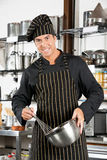 Male Chef Holding Wire Whisk And Mixing Bowl Stock Photos