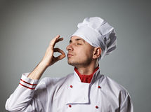 Male chef kissing fingers Royalty Free Stock Photos