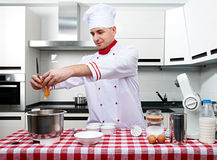 Male chef at kitchen Stock Images