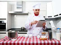 Male chef at kitchen Stock Photo