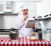 Male chef at kitchen Royalty Free Stock Images