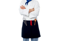 Male chef with kitchen utensils Stock Images