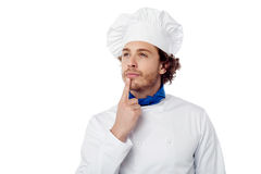 Male chef lost in deep thought. Chef trying to recall dish ingredients Royalty Free Stock Photography