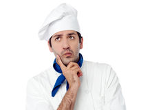 Male chef lost in deep thoughts Royalty Free Stock Photos