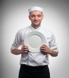 Male chef with plate isolated on white Stock Photography