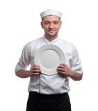 Male chef with plate isolated on white Royalty Free Stock Image