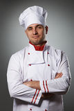 Male chef portrait. Against grey background Royalty Free Stock Photo