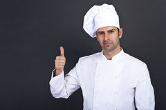Male chef portrait. Against grey background with thumb Stock Image