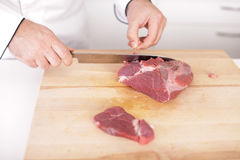 Male chef preparing meat stakes Royalty Free Stock Photography