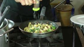Male chef preparing tasty food stock footage
