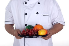 The male chef present healthy fruit Stock Photos