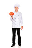 Male chef with a pumpkin Stock Photography