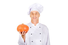 Male chef with a pumpkin Royalty Free Stock Photo