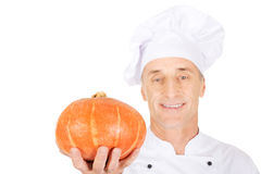 Male chef with a pumpkin Stock Images