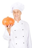 Male chef with a pumpkin Royalty Free Stock Photos