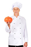 Male chef with a pumpkin Stock Photo